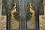 The exquisitely designed metal gate to the temple – with the motif of the peacock in full golden splendor.